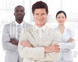 Business man smiling in front of Business team