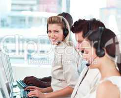 woman smiling at camera in a call centre