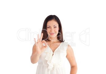 Woman showing Okay sign to the camera