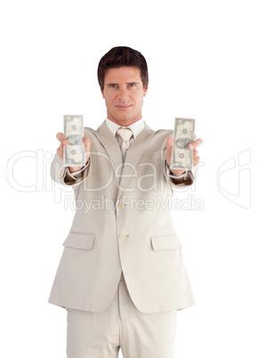 Businessman holding Dollars