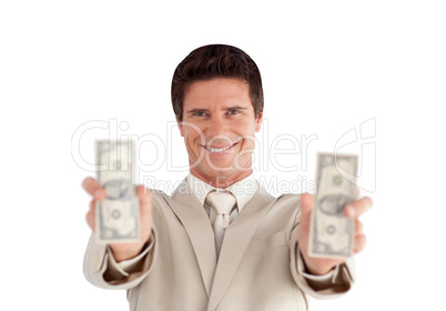 Businessman holding dollars in his hands