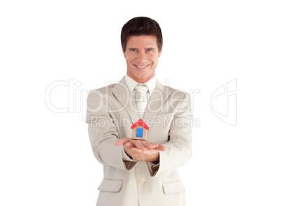 Businessman holding a house