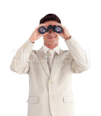 Man looking straight ahead through a binnoculars
