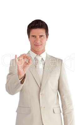 Business man showing Positive sign