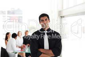 Serious Looking Businessman with arms Folded