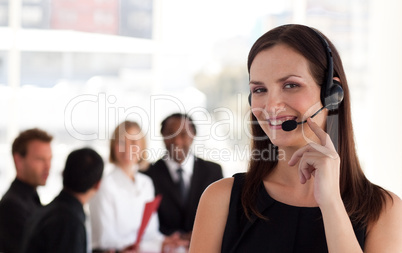 Young attractive woman talking on a headset