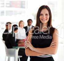 Happy business woman smiling at camera