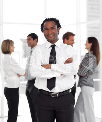 Potrait of a Businessman standing in front of team