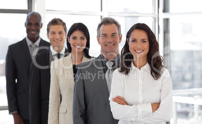 Hispanic Business woman leading a team of workers