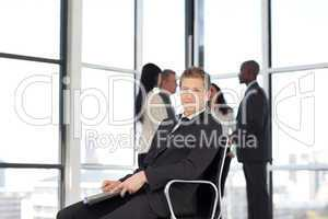 Businesss man in office sitting on chair
