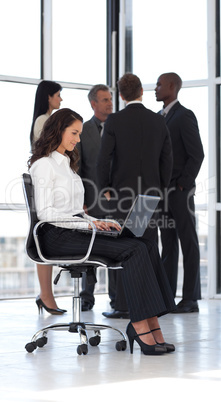 Young attractive businesswoman in office working