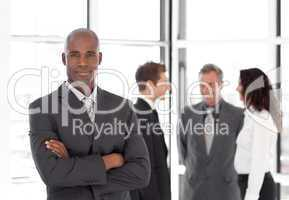Young Businessman standing out from the Crowd