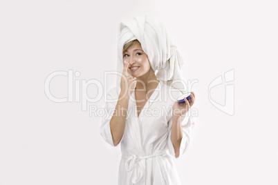 blond woman with cream box