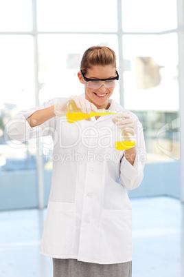 Beautiful scientist examining a test-tube
