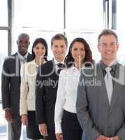 businesspeople from different cultures looking at camera