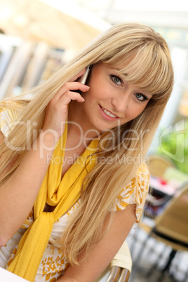 beautiful young blonde with a mobile phone