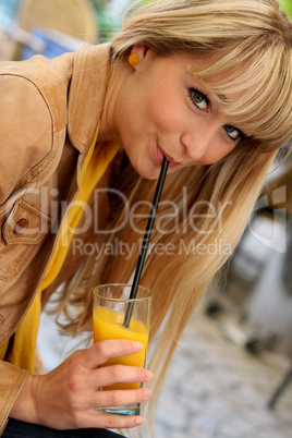 beautiful young blonde with a glass of juice
