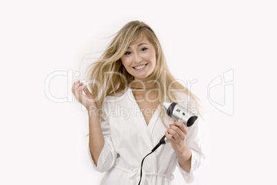 young blonde woman with hairdryer