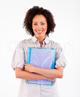 Businesswoman holding folders smiling at the camera