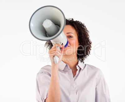 Businesswoman yelling through megaphone