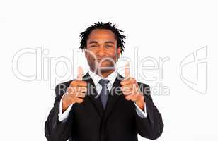 Attractive businessman with thumbs up