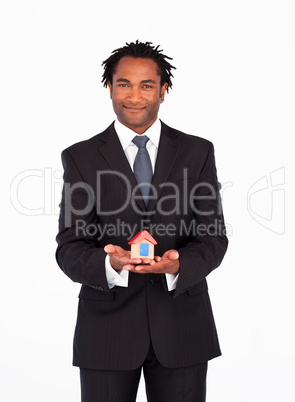Afro-american  businessman presenting a house