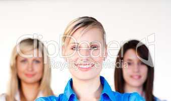 Portrait of three businesswomen smiling at the camera