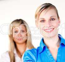 Businesswoman smiling at the camera with her colleague