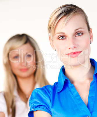 Businesswoman looking at the camera with her colleague