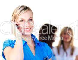 Smiling businesswoman speaking on the phone in office