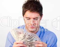 Handsome man counting dollars