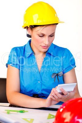 Young woman with hard hat focussing