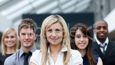 Smiling blonde businesswoman leading her team