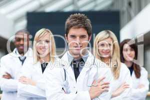 Handsome young doctor leading his team