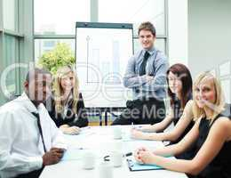 Handsome businessman in a meeting with his colleagues