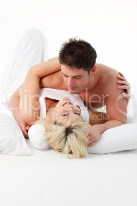 Smiling girl with her boy resting in bed