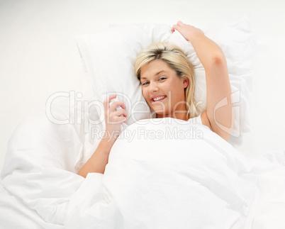 Smiling girl resting in bed
