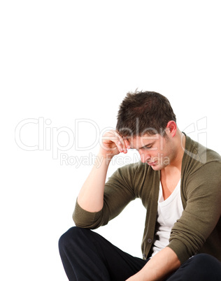 Depressed man sitting on the floor