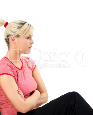 Worried woman sitting on the floor