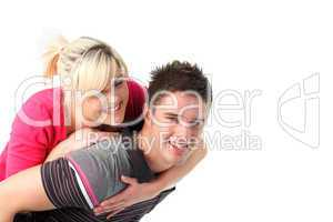 Boy giving his girlfriend piggyback ride