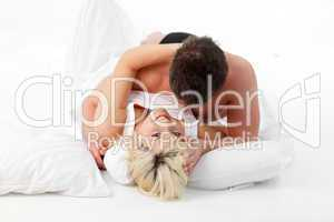 Young couple in love resting in bed