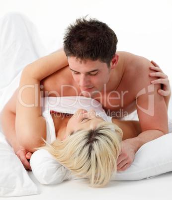 Portrait of a romantic couple on bed