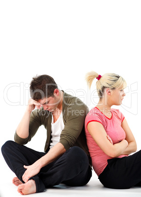 Couple in an argument sitting on the floor