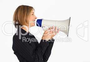 Profile of a smiling businesswoman with a megaphone