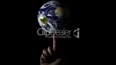 Globus auf einem Finger