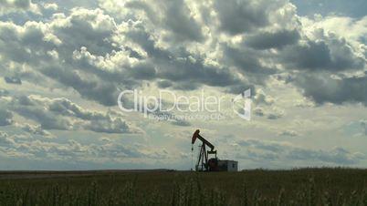 Oil pump jack in wheat field 3