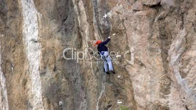 rock climber ascending on top.