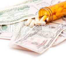 Pills and Dollars on white background