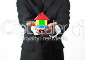 Close-up of an businessman presenting a sample of a house