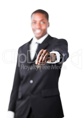 Young businessman holding a key